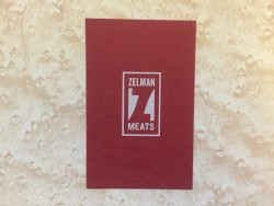 Zelman Meats business card